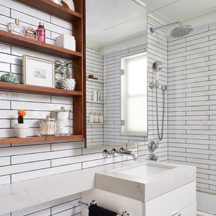 Small trendy kids' ceramic tile and white tile marble floor and gray floor bathroom photo in New York with flat-panel cabinets, white cabinets, a one-piece toilet, an undermount sink, quartz countertops and white countertops