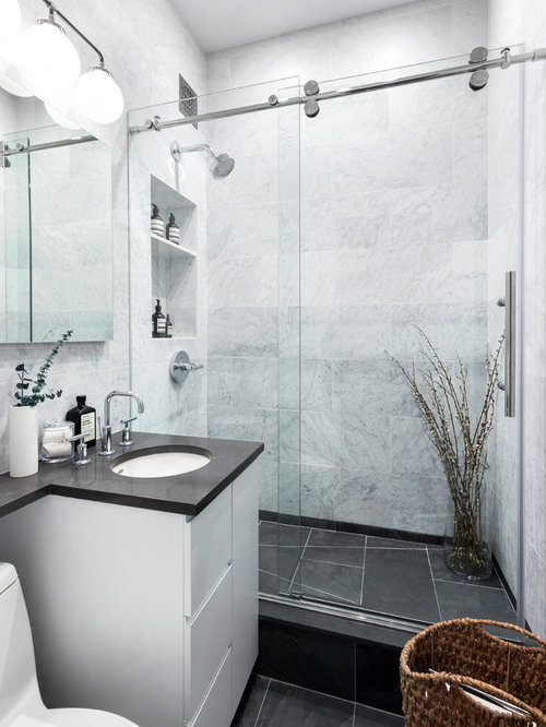 Example of a small trendy 3/4 white tile and marble tile black floor  bathroom