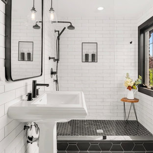 Bathroom - small transitional 3/4 white tile and subway tile ceramic tile and black floor bathroom idea in Seattle with a pedestal sink and white walls