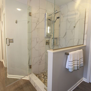 Bathroom - mid-sized transitional master porcelain tile laminate floor and brown floor bathroom idea in Cleveland with flat-panel cabinets, white cabinets, gray walls, an undermount sink, quartz countertops and a hinged shower door