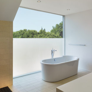 Photo of a small modern ensuite bathroom in Los Angeles with a freestanding bath, beige tiles, porcelain tiles, white walls, porcelain flooring and engineered stone worktops.