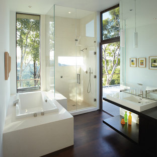 Inspiration for a mid-sized modern master beige tile and stone tile dark wood floor bathroom remodel in Los Angeles with a vessel sink, open cabinets, dark wood cabinets, wood countertops and white walls
