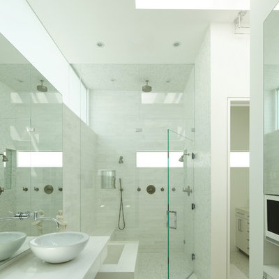 Inspiration for a mid-sized modern master white tile and stone tile mosaic tile floor double shower remodel in Los Angeles with a vessel sink, flat-panel cabinets, white cabinets, marble countertops, white walls and white countertops