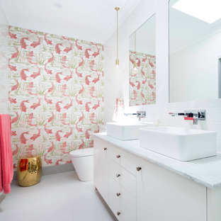 Inspiration for a small contemporary master bathroom in Canberra - Queanbeyan with furniture-like cabinets, white cabinets, a double shower, a one-piece toilet, white tile, subway tile, white walls, porcelain floors, a vessel sink, marble benchtops and grey floor.