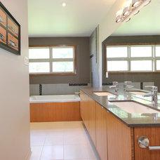 Modern Bathroom by OakWood Renovation Experts