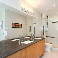 Modern Bathroom by OakWood Renovation Experts