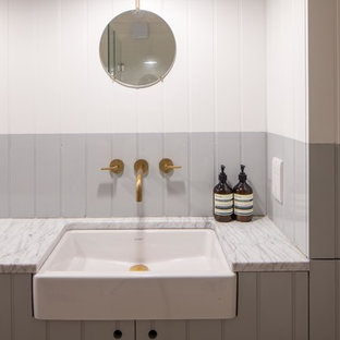 This is an example of a scandi family bathroom in London with shaker cabinets, grey cabinets, grey walls, a trough sink and marble worktops.