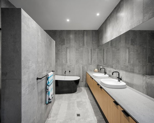 design ideas for a mid sized contemporary master bathroom in adelaide with flat panel