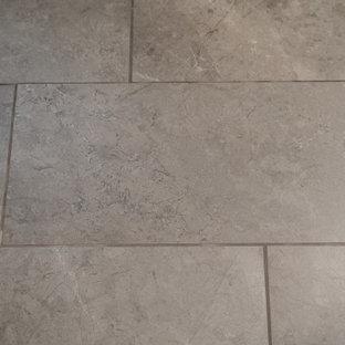 コロンバスの大きいトラディショナルスタイルのおしゃれなマスターバスルーム (フラットパネル扉のキャビネット、白いキャビネット、コーナー設置型シャワー、黄色いタイル、青い壁、珪岩の洗面台、茶色い床、青い洗面カウンター) の写真