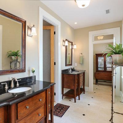 Mid-sized elegant master beige tile and porcelain tile porcelain tile bathroom photo in Charleston with an undermount sink, dark wood cabinets, furniture-like cabinets and beige walls