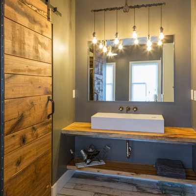 Inspiration for a mid-sized cottage master white tile and subway tile dark wood floor and brown floor bathroom remodel in Detroit with open cabinets, wood countertops, medium tone wood cabinets, brown countertops, a two-piece toilet, gray walls, a wall-mount sink and a hinged shower door
