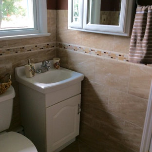 Mid-sized elegant 3/4 brown tile and ceramic tile porcelain tile and beige floor alcove shower photo in Philadelphia with an integrated sink, raised-panel cabinets, white cabinets, solid surface countertops, red walls and a two-piece toilet