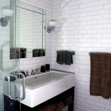 Traditional Powder Room by Orren Pickell Building Group