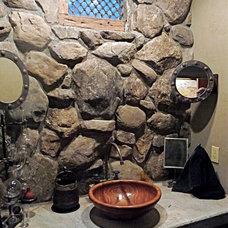 Rustic Bathroom by Interior Analysis