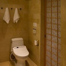 Asian Bathroom by Jochum Architects