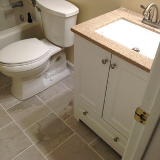 Small transitional 3/4 white tile and porcelain tile porcelain tile bathroom photo in Other with an integrated sink, flat-panel cabinets, white cabinets, solid surface countertops, a one-piece toilet and beige walls