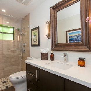Inspiration for a mid-sized transitional 3/4 beige tile and porcelain tile porcelain floor bathroom remodel in Miami with flat-panel cabinets, brown cabinets, a one-piece toilet, white walls, an undermount sink and quartz countertops
