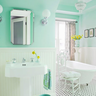 This is an example of a mid-sized traditional bathroom in Nashville with a pedestal sink, a claw-foot tub, white tile, ceramic tile, green walls, mosaic tile floors and multi-coloured floor.
