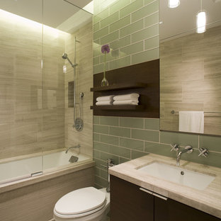 Inspiration for a mid-sized contemporary bathroom remodel in Chicago with an undermount sink, dark wood cabinets, a one-piece toilet and gray walls