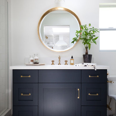 Inspiration for a mid-sized coastal multicolored tile bathroom remodel in Los Angeles with black cabinets, marble countertops, white walls, a console sink and shaker cabinets