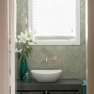 Small eclectic 3/4 green tile and ceramic tile ceramic floor and gray floor bathroom photo in Other with open cabinets, gray cabinets, a vessel sink, tile countertops and blue walls