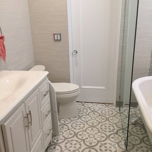 Inspiration for a mid-sized mediterranean 3/4 bathroom in Los Angeles with furniture-like cabinets, white cabinets, a claw-foot tub, a shower/bathtub combo, a one-piece toilet, gray tile, subway tile, grey walls, cement tiles, an integrated sink, tile benchtops, grey floor and an open shower.