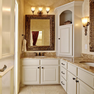 Inspiration for a timeless bathroom remodel in Dallas with an undermount sink, raised-panel cabinets and beige cabinets
