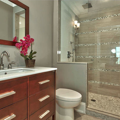 Inspiration for a mid-sized transitional 3/4 porcelain tile alcove shower remodel in Toronto with flat-panel cabinets, medium tone wood cabinets, a one-piece toilet, gray walls and an undermount sink