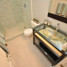 Modern Bathroom by The Design Den Homes Inc.