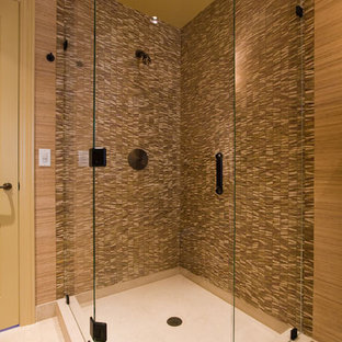 Corner shower - mid-sized eclectic 3/4 beige tile and stone tile limestone floor corner shower idea in San Francisco with a vessel sink, flat-panel cabinets, dark wood cabinets, limestone countertops, a one-piece toilet and brown walls