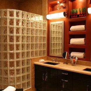 Imagen de cuarto de baño principal, actual, de tamaño medio, con lavabo sobreencimera, armarios con paneles lisos, puertas de armario negras, encimera de piedra caliza, ducha a ras de suelo, baldosas y/o azulejos beige, losas de piedra y parades naranjas