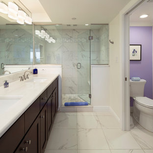 Alcove shower - transitional master gray tile and white tile white floor alcove shower idea in Miami with recessed-panel cabinets, brown cabinets, a two-piece toilet, white walls, an undermount sink, a hinged shower door and white countertops