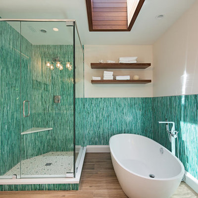 Example of an island style master blue tile, green tile and matchstick tile brown floor bathroom design in Miami with beige walls and a hinged shower door