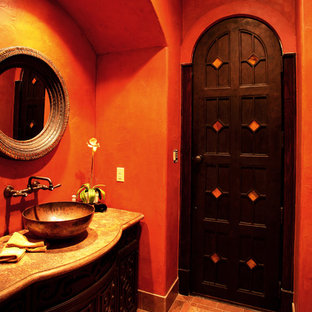 Example of a small tuscan 3/4 ceramic floor bathroom design in Austin with beaded inset cabinets, dark wood cabinets, red walls and granite countertops
