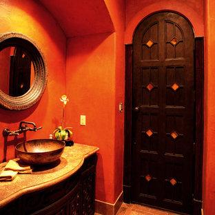 Diseño de cuarto de baño con ducha, mediterráneo, pequeño, con armarios con rebordes decorativos, puertas de armario de madera en tonos medios, paredes rojas, suelo de baldosas de cerámica y encimera de granito