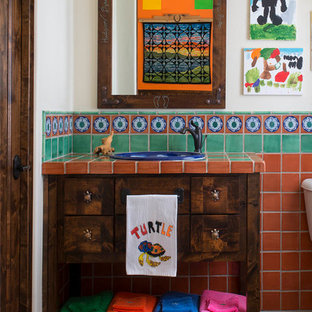 This is an example of a family bathroom in Dallas with dark wood cabinets, multi-coloured tiles, terracotta tiles, a built-in sink, tiled worktops, freestanding cabinets and white walls.