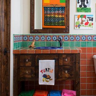 На фото: детская ванная комната с темными деревянными фасадами, разноцветной плиткой, терракотовой плиткой, накладной раковиной, столешницей из плитки, фасадами островного типа и белыми стенами с