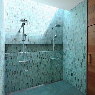 Photo of a large contemporary master bathroom in San Francisco with a double shower, blue tile, blue walls, glass tile, porcelain floors and grey floor.