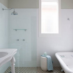 Transitional subway tile claw-foot bathtub photo in Sydney with a console sink