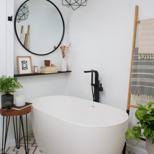 Mid-sized danish master white tile and marble tile cement tile floor and beige floor bathroom photo in Los Angeles with flat-panel cabinets, medium tone wood cabinets, a one-piece toilet, white walls, an undermount sink, granite countertops, a hinged shower door and black countertops