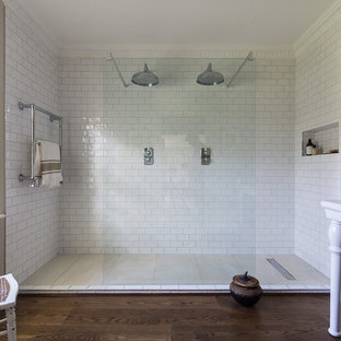 Photo of a large classic bathroom in London with white tiles, beige walls, dark hardwood flooring, brown floors, a double shower, metro tiles and a console sink.