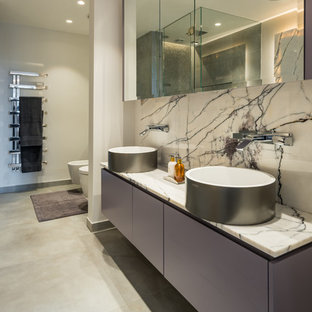 Design ideas for a contemporary ensuite bathroom in London with flat-panel cabinets, grey cabinets, a bidet, a vessel sink, grey floors, white tiles and white walls.