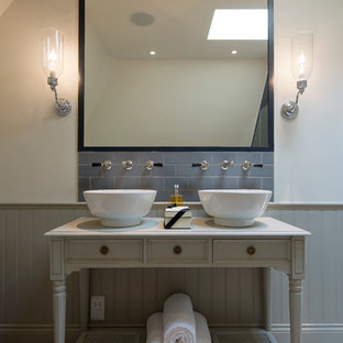 Design Ideas For A Traditional Bathroom In London With Open Cabinets Grey Tiles Metro