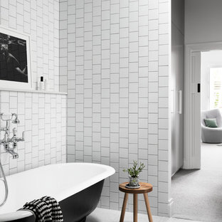 Contemporary master bathroom in Melbourne with flat-panel cabinets, black cabinets, a claw-foot tub, a corner shower, a wall-mount toilet, white tile, ceramic tile, white walls, marble floors, a console sink, engineered quartz benchtops, grey floor, a hinged shower door and white benchtops.