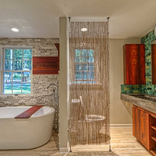 This is an example of a large midcentury 3/4 bathroom in Other with a freestanding tub, a trough sink, flat-panel cabinets, dark wood cabinets, concrete benchtops, green tile, beige walls, a two-piece toilet, porcelain floors, beige floor, a corner shower, an open shower and cement tile.
