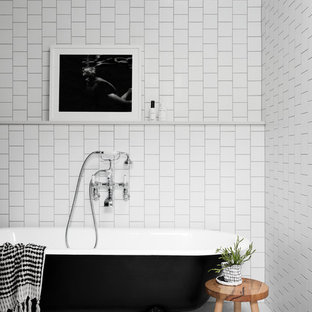 Large contemporary master bathroom in Melbourne with a claw-foot tub, white tile, subway tile, terrazzo floors and grey floor.