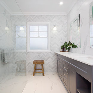 Photo of a transitional master bathroom in Brisbane with shaker cabinets, grey cabinets, a curbless shower, white walls, an undermount sink, white floor, an open shower and white benchtops.
