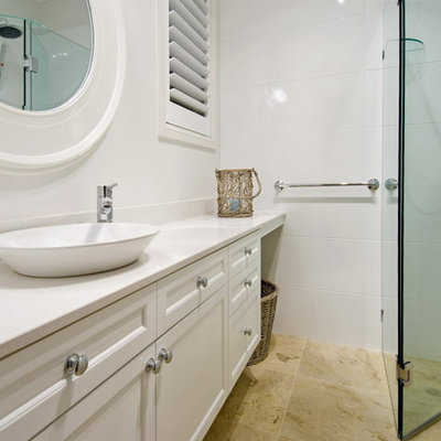 Inspiration for a mid-sized timeless white tile and subway tile mosaic tile floor freestanding bathtub remodel in Gold Coast - Tweed with recessed-panel cabinets, marble countertops and white walls
