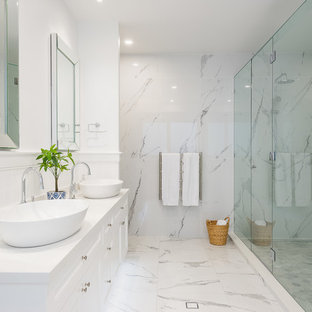 Large beach style master bathroom in Gold Coast - Tweed with white cabinets, marble, white walls, marble floors, a vessel sink, white floor, a hinged shower door, white benchtops, an alcove shower and white tile.