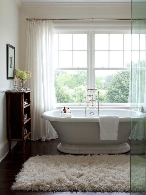 Inspiration For A Huge Transitional Master Dark Wood Floor Freestanding Bathtub Remodel In New York With